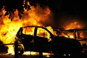 144857-cars-burn-on-a-street-in-ealing-london-august-9-2011